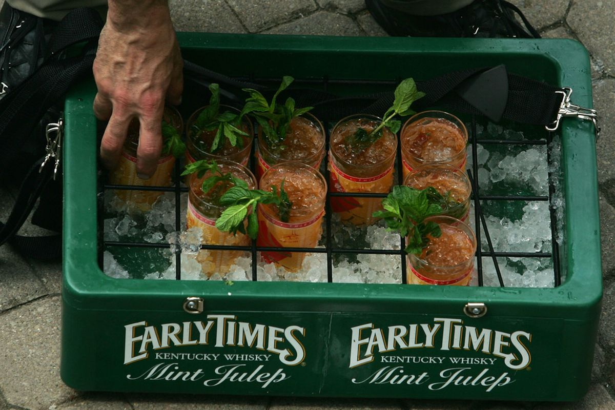 LOUISVILLE, KY - MAY 05: A vendor sells 'Mint Juleps' during the 133rd Kentucky Derby on May 5, 2007 at Churchill Downs in Louisville, Kentucky. (Photo by Jamie Squire/Getty Images)