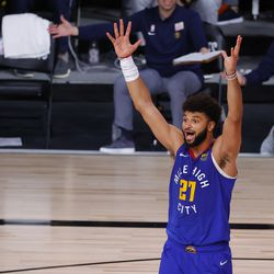 Denver Nuggets' Jamal Murray reacts after a foul call during the third quarter against the Utah Jazz in Game 4 of an NBA basketball first-round playoff series, Sunday, Aug. 23, 2020, in Lake Buena Vista, Fla.