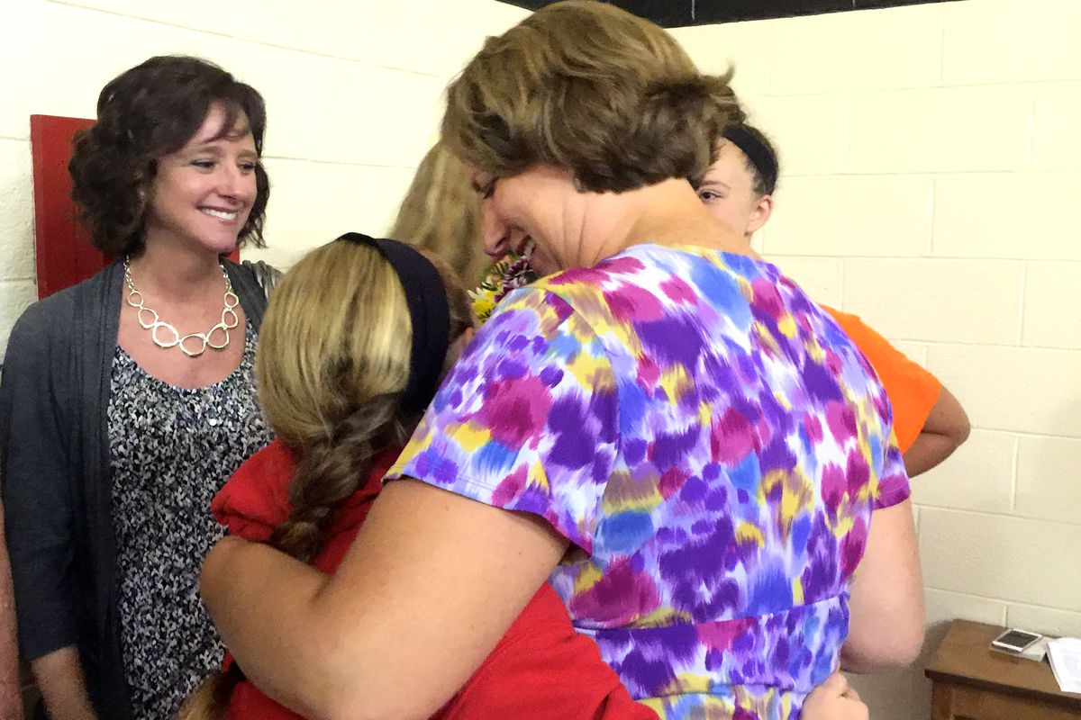 IPS teacher of the year Amy Wackerly hugs her daughter after the announcement at School 2 in June.