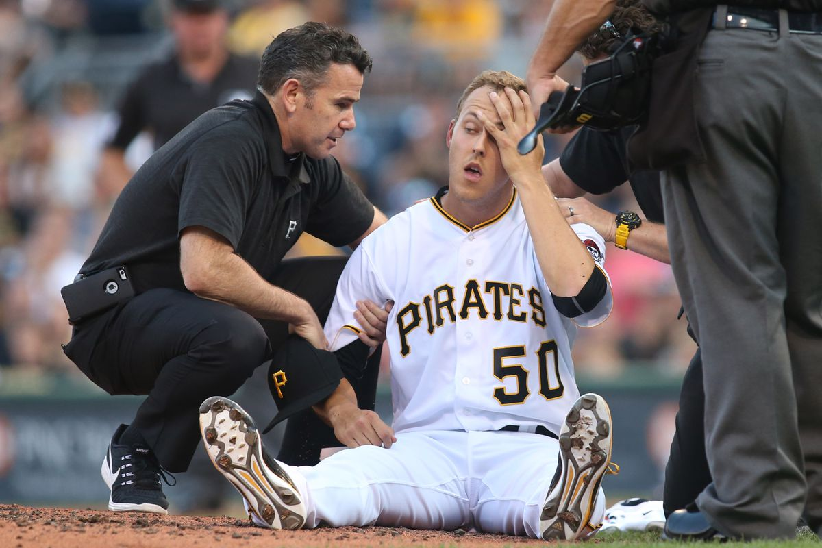 Jameson Taillon is treated after being hit in the head by a line drive