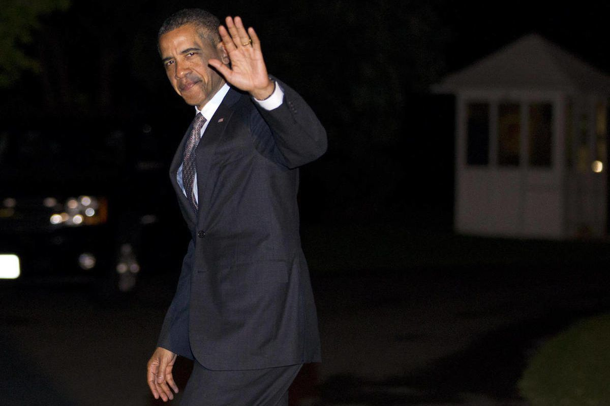 President Barack Obama waves as he arrives on the South Lawn of the White House on Wednesday, April 18, 2012, in Washington.