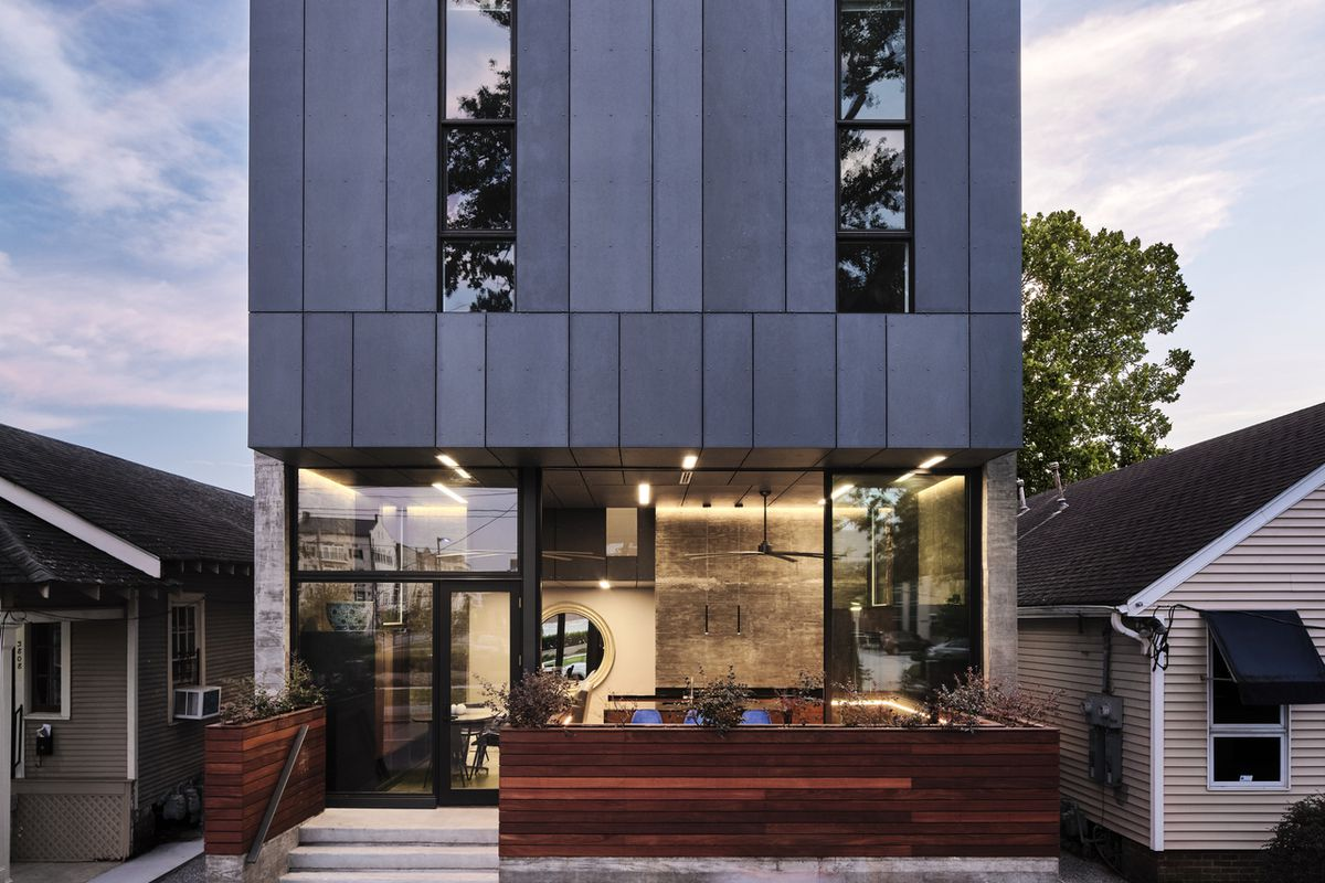 Front of modern two-story home with exterior deck.