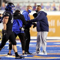 Boise State Broncos head coach Bryan Harsin and Brigham Young Cougars head coach Kalani Sitake meet at midfield after BYU defeats Boise State 51-17 in a college football game at Albertsons Stadium in Boise on Friday, Nov. 6, 2020.
