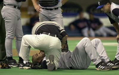 Minneapolis, Mn., Thurs., May 15, 2003—Kansas City Royals first baseman Ken Harvey was helped out by teammates and staff after he fell after trying to catch a ball. (I think he may have injured his wrist.) Later in the game he was hit by a pitch. GE