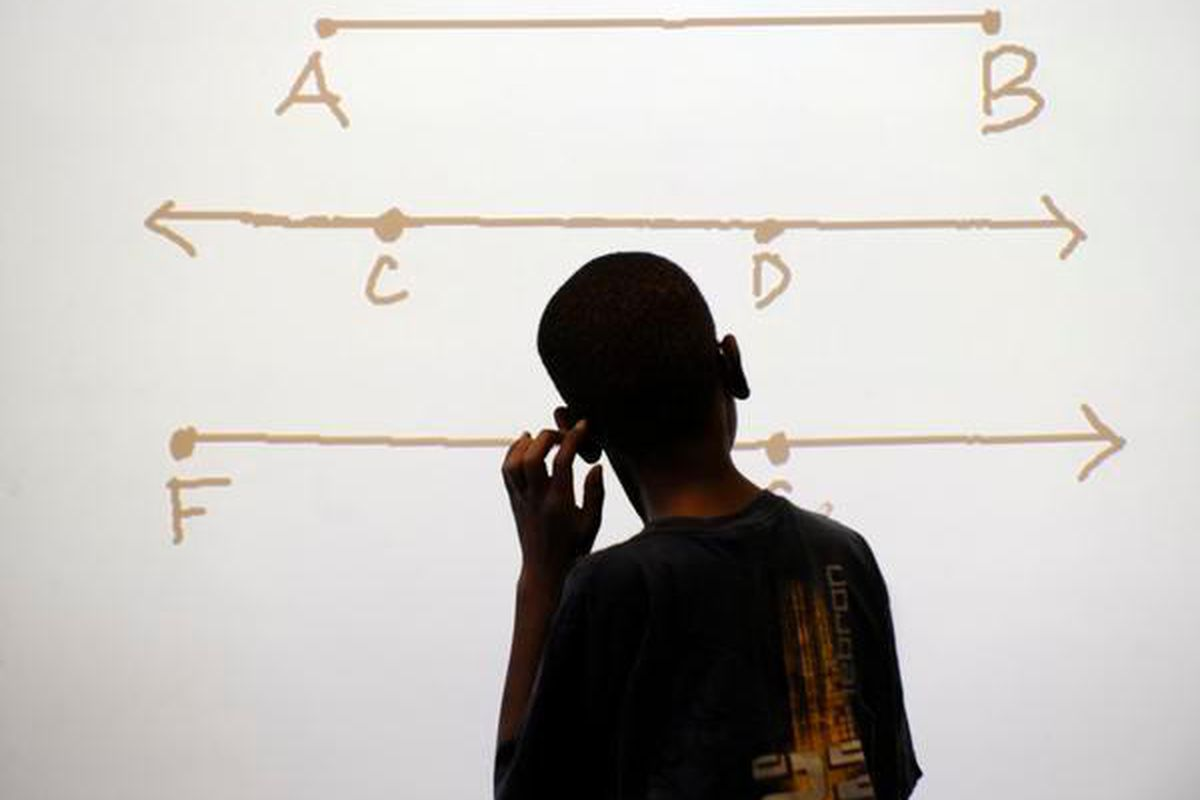 A Stedman Elementary student scratches his head as he considers a math problem.