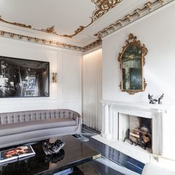 """Catherine understood the importance of highlighting the gilded ceiling and massive amount of ornate moulding. The decision was made early on to keep the room's original ceilings. """"I loved the intricate detail of the original ceiling, said Catherine. """"It's"""