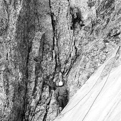 Ted Wilson leads Rick Reese on the Northwest Chimney, Grand Teton, in 1970.