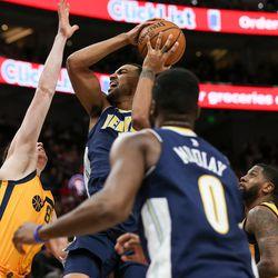 Denver Nuggets forward Trey Lyles (7) goes up against Utah Jazz forward Jonas Jerebko (8) at Vivint Smart Home Arena in Salt Lake City on Tuesday, Nov. 28, 2017.