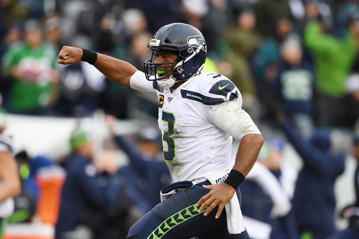 Seattle Seahawks quarterback Russell Wilson reacts after a 58 yard touchdown run by running back Rashaad Penny in the fourth quarter at Lincoln Financial Field.