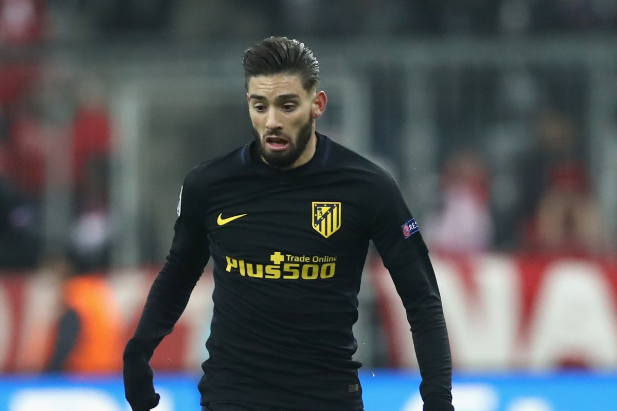 Yannick Carrasco stands by Diego Simeone Into the Calderon