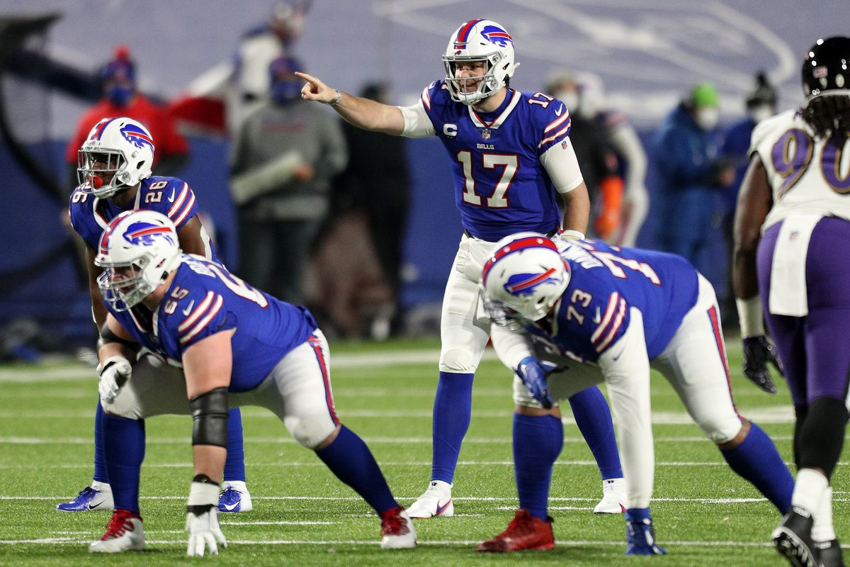 Josh Allen #17 of the Buffalo Bills signals before the snap in the first quarter against the Baltimore Ravens during the AFC Divisional Playoff game at Bills Stadium on January 16, 2021 in Orchard Park, New York.
