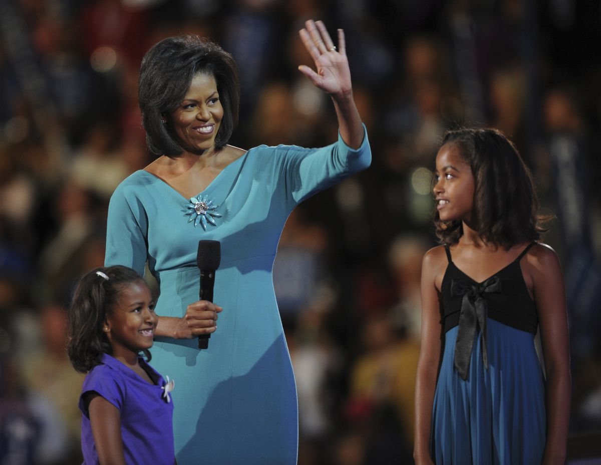On the first day of the Democratic National Convention, Michelle Obama spoke to the crowd about her husband at the Pepsi Center. Her daughters Sasha, 7, left, and Malia, 10, join her on stage.