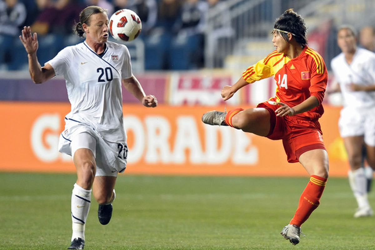 CHESTER PA - OCTOBER 06: Li Danyang #14 of China deflects the ball towards Abby Wambach #20 of the United States at PPL Park on October 6 2010 in Chester Pennsylvania. The match ended in a 1-1 tie. (Photo by Drew Hallowell/Getty Images)