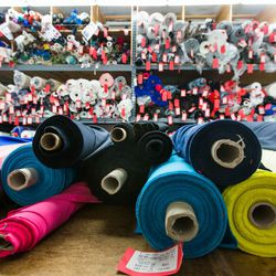 Rolls of Black Halo fabric inside the production offices.