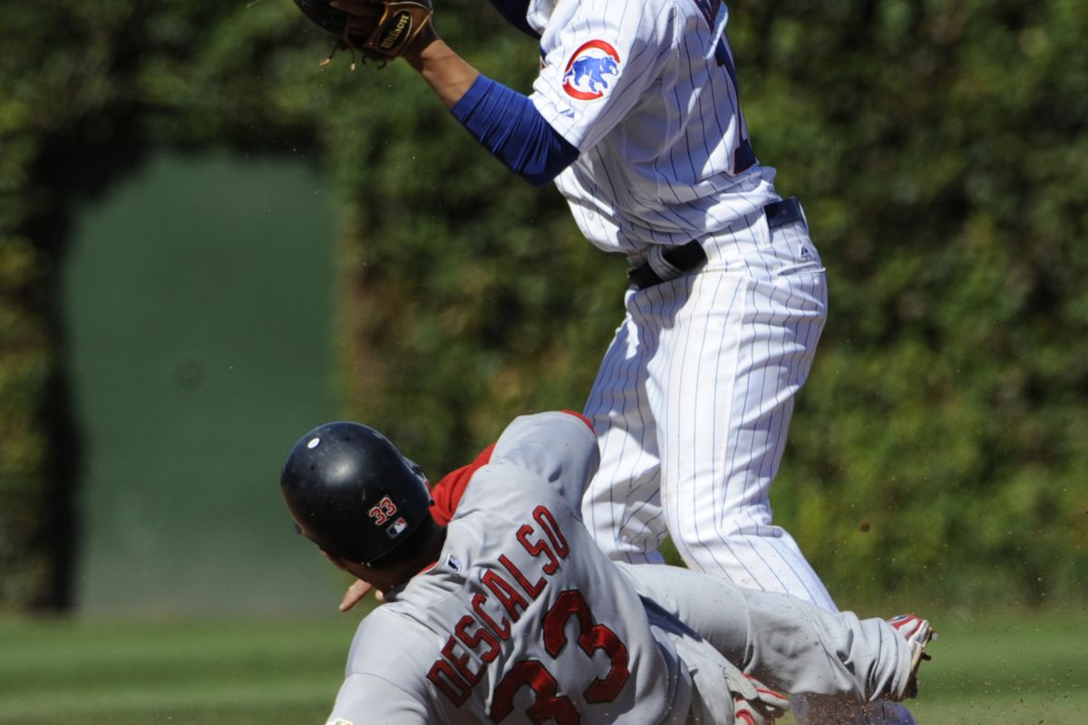 Darwin Barney of the Chicago Cubs forces out Daniel Descalso of the St. Louis Cardinals at Wrigley Field in Chicago, Illinois.  (Photo by David Banks/Getty Images)
