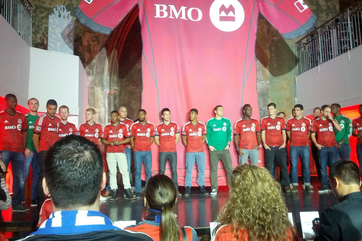 Toronto FC players about to be crushed by a giant TFC kit!