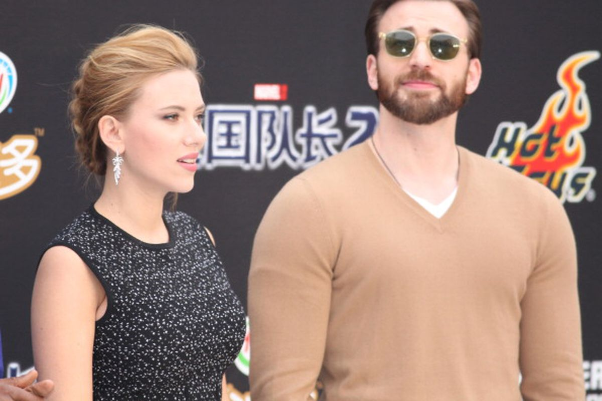 Actress Scarlett Johansson and actor Chris Evans attend 'Captain America: The Winter Soldier' premiere at Taikoo Li Sanlitun on March 24, 2014 in Beijing, China