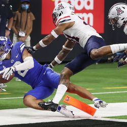 Brigham Young Cougars wide receiver Neil Pau'u (2) dives for a touchdown during the Vegas Kickoff Classic in Las Vegas on Saturday, Sept. 4, 2021. BYU won 24-16.