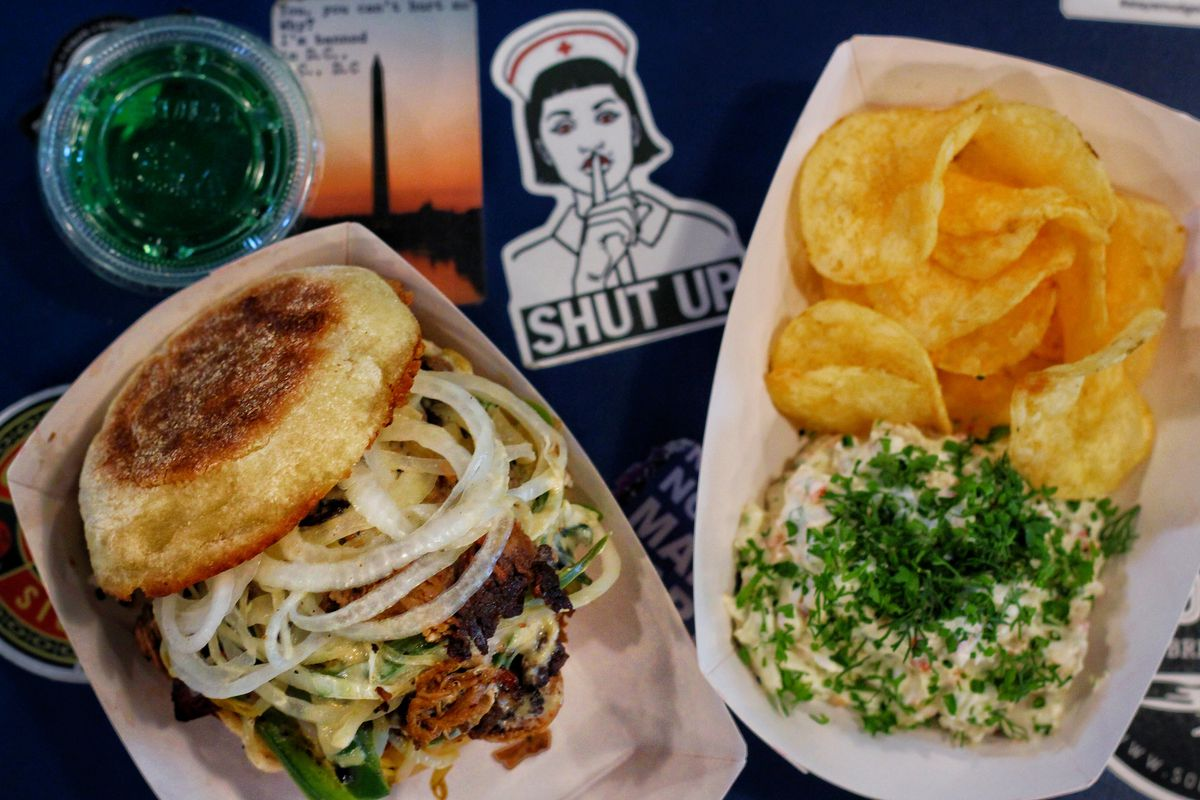 A brisket and longganisa sausage Houston sandwich, left, and a serving of clams casino dip with chips