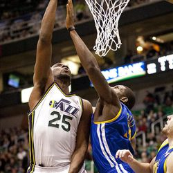 Jazz Al Jefferson (25) goes up for a basket during the first half of the NBA basketball game between the Utah Jazz and the Golden State Warriors at Energy Solutions Arena, Wednesday, Dec. 26, 2012.