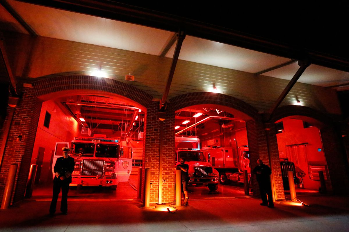 The garage at Unified Fire Station #124 in Riverton is illuminated during the Light the Night ceremony on Monday, Sept. 28, 2020.