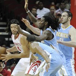 Houston Rockets' Luis Scola (4) works against Denver Nuggets' Arron Afflalo, front, Kenneth Faried, center, and Kosta Koufos (41) during the first half of an NBA basketball game Monday, April 16, 2012, in Houston.