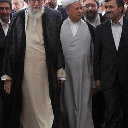 In this photo taken on Thursday, Aug. 30, 2012, and released by an official website of the Iranian supreme leader's office, supreme leader Ayatollah Ali Khamenei, left, chief of Expediency Council, Akbar Hashemi Rafsanjani, center, and President Mahmoud Ahmadinejad, right, arrive at the opening session of the Nonaligned Movement, NAM, summit, in Tehran, Iran.