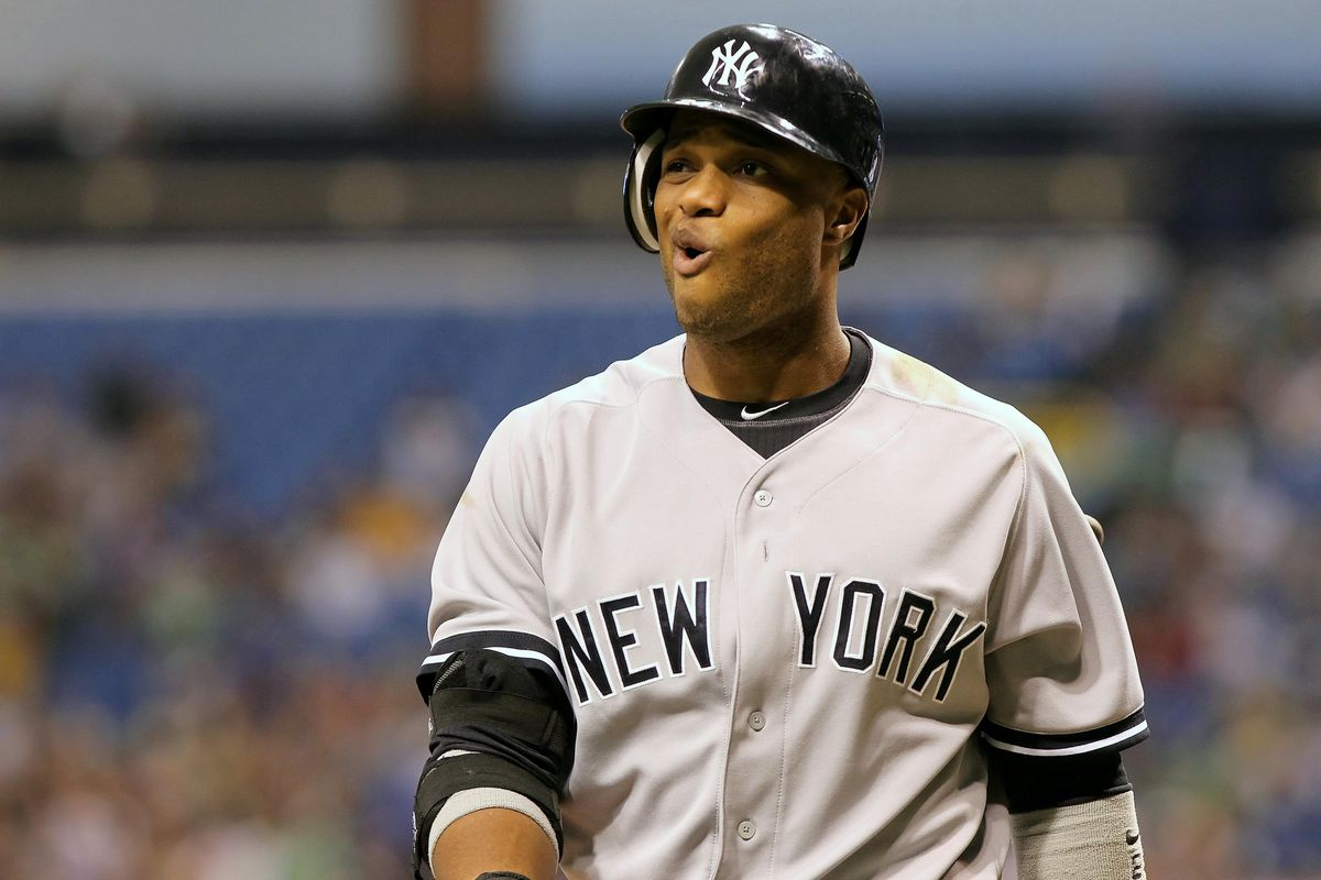 New York Yankees second baseman Robinson Cano reacts after he stuck out in the ninth inning against the Tampa Bay Rays at Tropicana Field. The Tampa Bay Rays defeated the New York Yankees 5-2. Mandatory Credit: Kim Klement-US PRESSWIRE