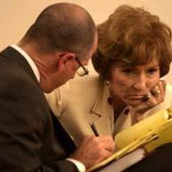 Salt Lake County Mayor Nancy Workman consults with her attorney, Jack Morgan, before the start of the preliminary hearing.