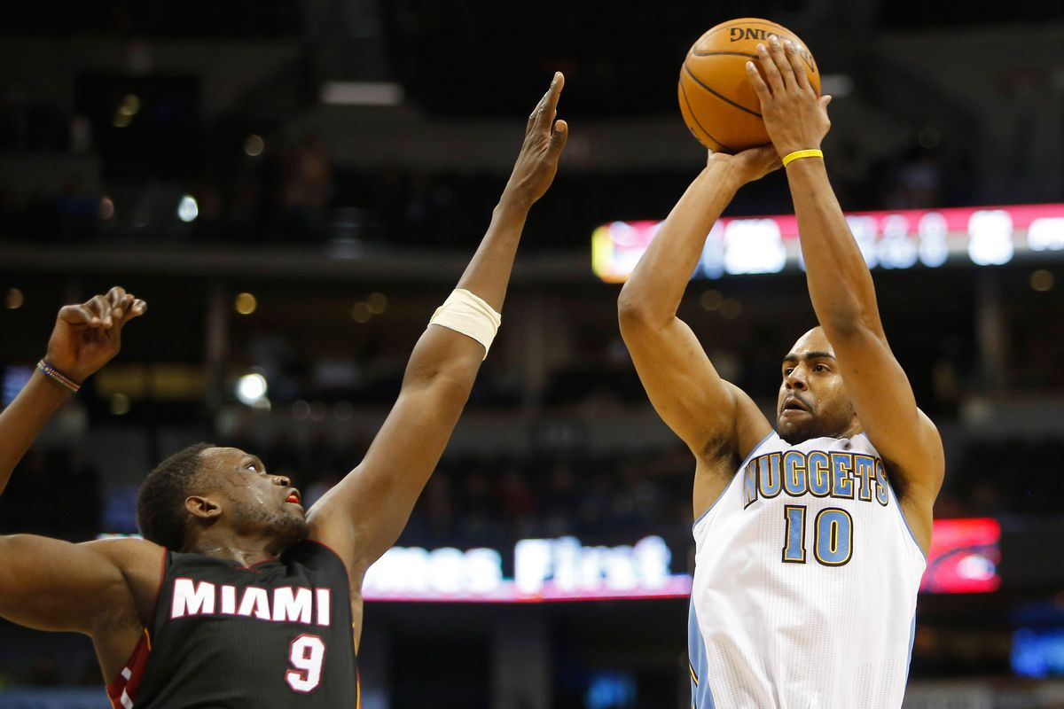 Denver Nuggets guard Arron Afflalo (R) took the lead early to secure a runaway win.