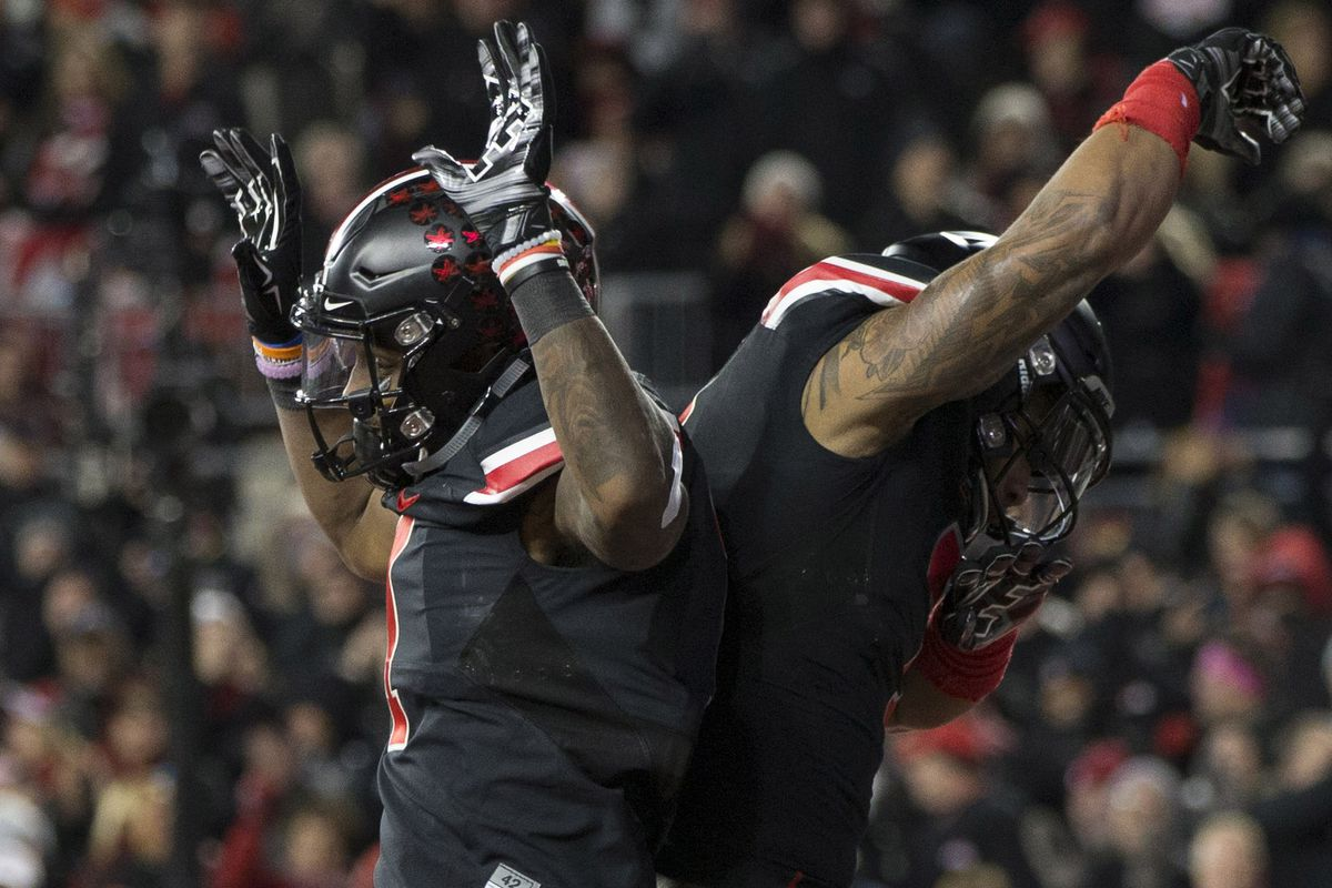 Ohio State wears awesome, black Nike uniforms, Nike gives Ohio State giant piles of cash. Perfect.