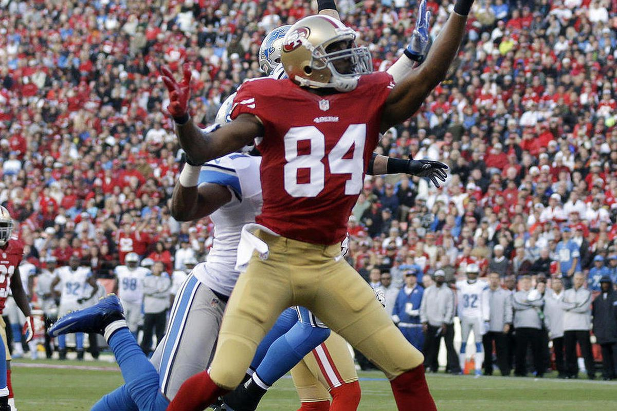 San Francisco 49ers wide receiver Randy Moss reaches for a pass, but Detroit Lions cornerback Jacob Lacey is called for interference on the play, during the first quarter of an NFL football game in San Francisco, Sunday, Sept. 16, 2012.