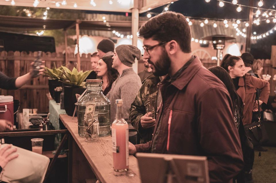 Crowd at outdoor food and beverage event at night