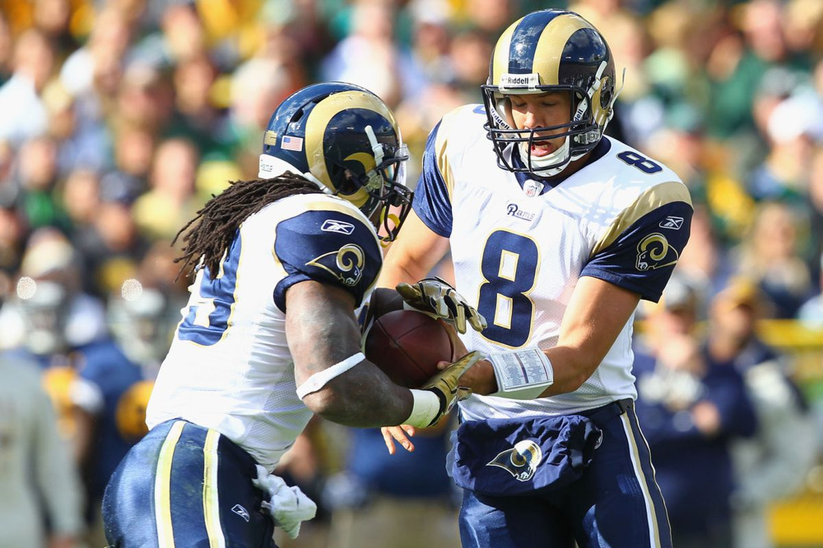 Sam Bradford #8 of the St. Louis Rams hands the ball off to Steven Jackson #39 also of the St. Louis Rams at Lambeau Field on October 16, 2011 in Green Bay, Wisconsin.  The Packers beat the Rams 24-3.  (Photo by Dilip Vishwanat/Getty Images)