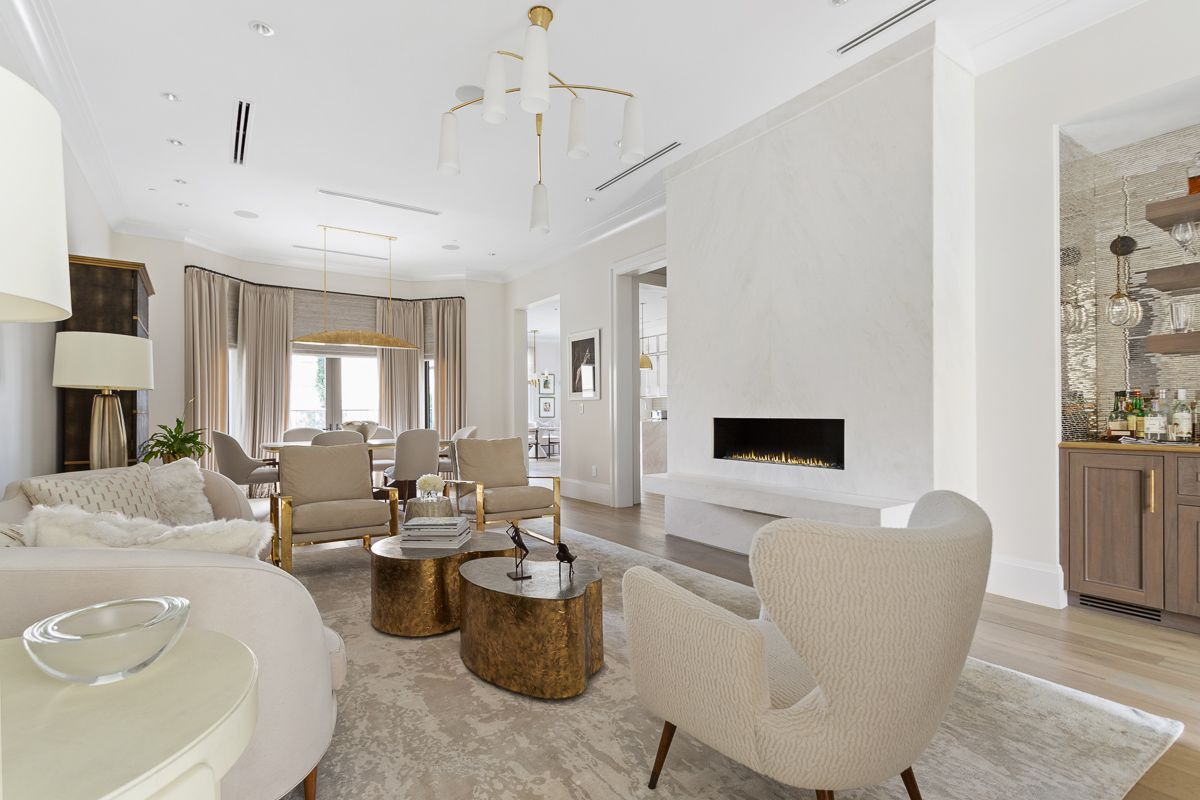 A huge white living room in a townhouse in Atlanta.