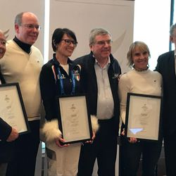 Park City resident and three-time aerial Olympian Tracy Evans poses with IOC president Thomas Bach (Center) and four other former Olympians being honored for their humanitarian efforts.