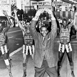 Ernie does calisthenics with the Harlem Globetrotters in San Francisco, January 17, 1962