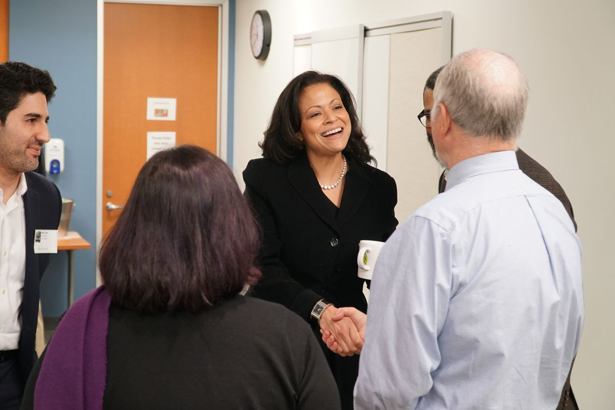 Silicon Valley Community Foundation CEO Nicole Taylor shakes hands with visitors.