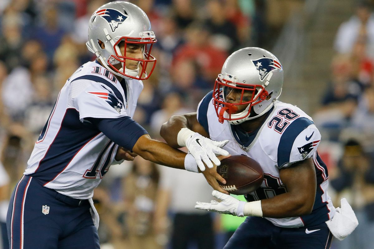 RB James White gets the handoff from Jimmy Garoppolo