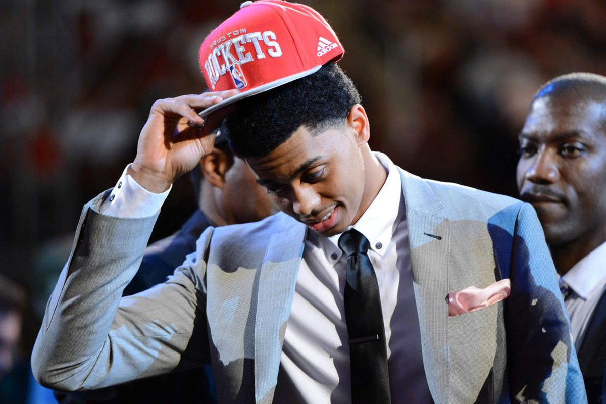June 28, 2012; Newark, NJ, USA; Jeremy Lamb (Connecticut) puts on a cap after being introduced as the number twelve overall pick to the Houston Rockets during the 2012 NBA Draft at the Prudential Center.  Mandatory Credit: Jerry Lai-US PRESSWIRE