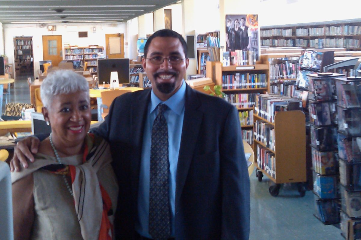 State Education Commissioner John King visits in 2013 with second cousin Stephanie Smith, a librarian at George Wingate Educational Complex since 1969.