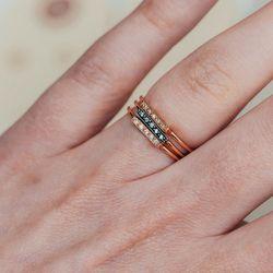 "Blanca Monros Gomez Diamond & Gold Bar Stacking Rings, <a href=""http://shop.thistleclover.com/collections/blanca-monros-gomez/products/blanca-monros-gomez-diamond-yellow-gold-bar-stacking-ring"">$410</a>"
