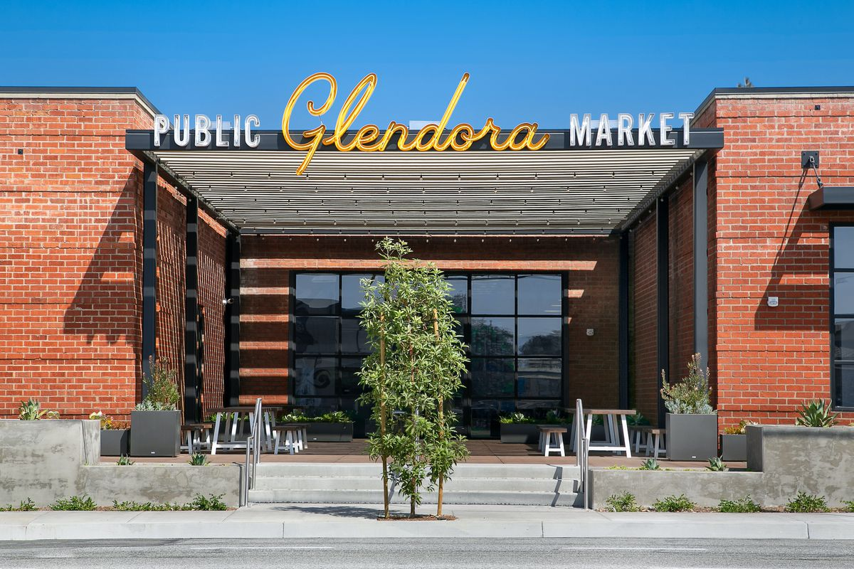 An exterior shot of a brick building that has been repurposed as a food hall.