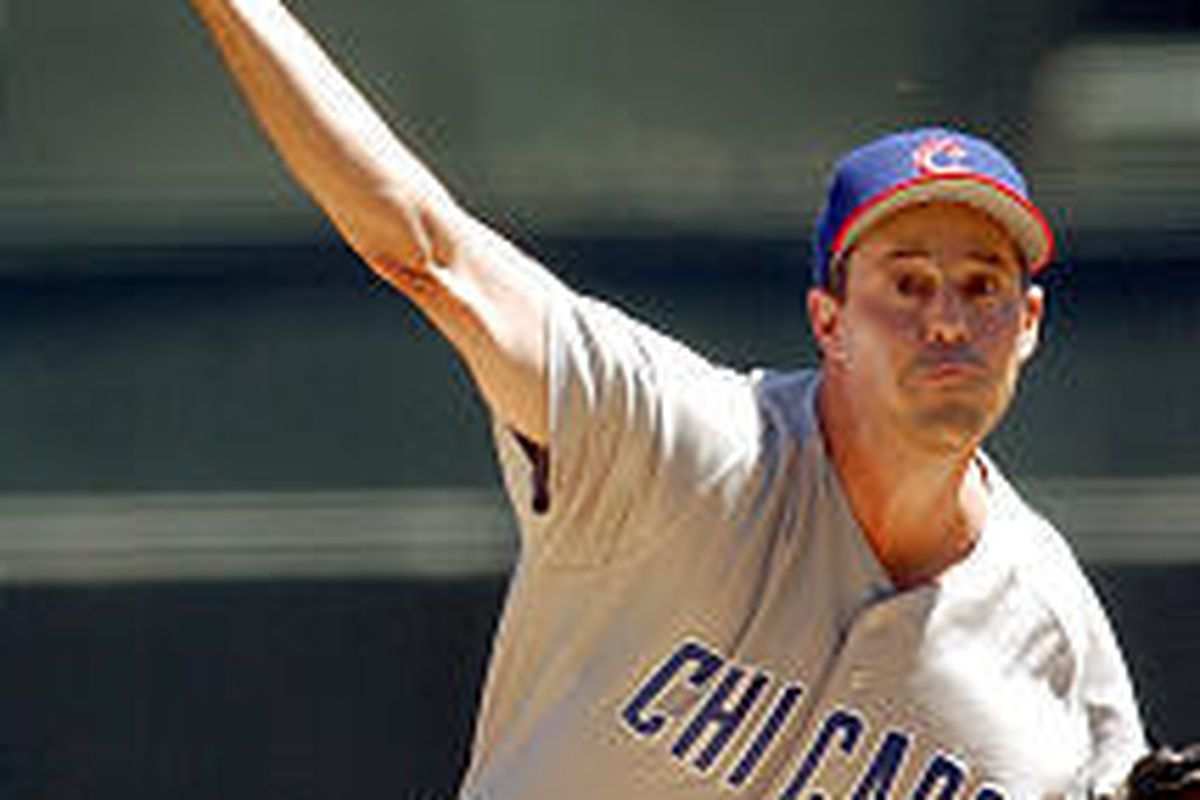 Chicago Cubs pitcher Greg Maddux works against the San Francisco Giants during the first inning Saturday. He went on to win the game \\\\— the 300th victory of his career.