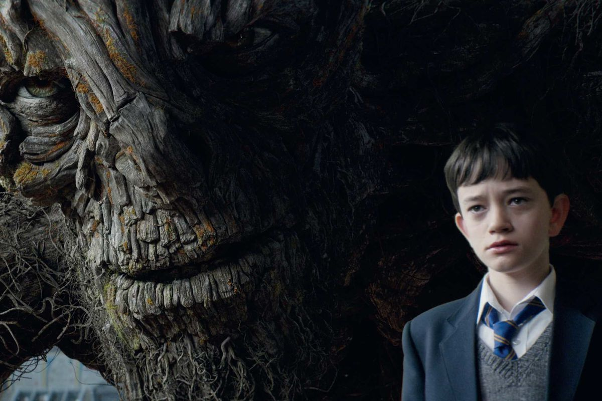 The yew tree monster and Conor in A Monster Calls.