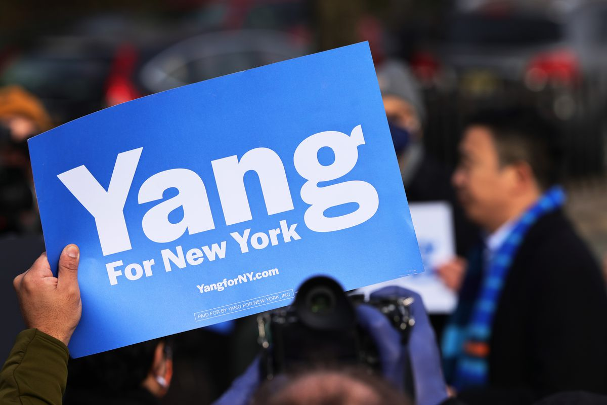 """A blue sign reading """"Yang for New York."""""""