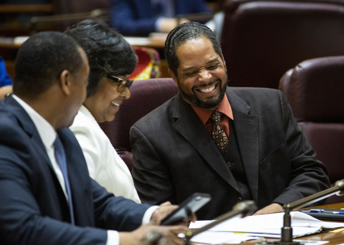 Alds. Anthony Beale (9th) laughs with Alds. Michelle Harris (8th) and Gregory Mitchell (7th) during Mayor Lori Lightfoot's first Chicago City Council meeting at City Hall, Wednesday, May 29, 2019.