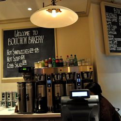 Coffee and the menu board at Bouchon Bakery.