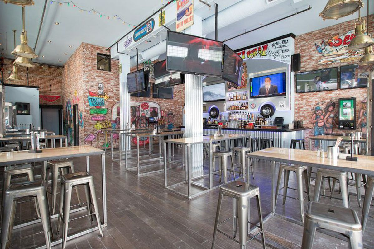 """<a href=""""http://la.eater.com/archives/2013/09/03/enjoy_shots_burgers_and_tvs_galore_at_rusty_mullet.php"""">Rusty Mullet, LA</a>."""