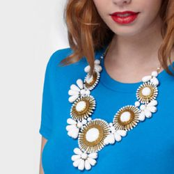 """Gold & White Waikiki Statement Necklace, <a href=""""http://www.fredflare.com/ACCESSORIES-jewelry/Gold-and-White-Waikiki-Statement-Necklace/"""">$44</a>"""